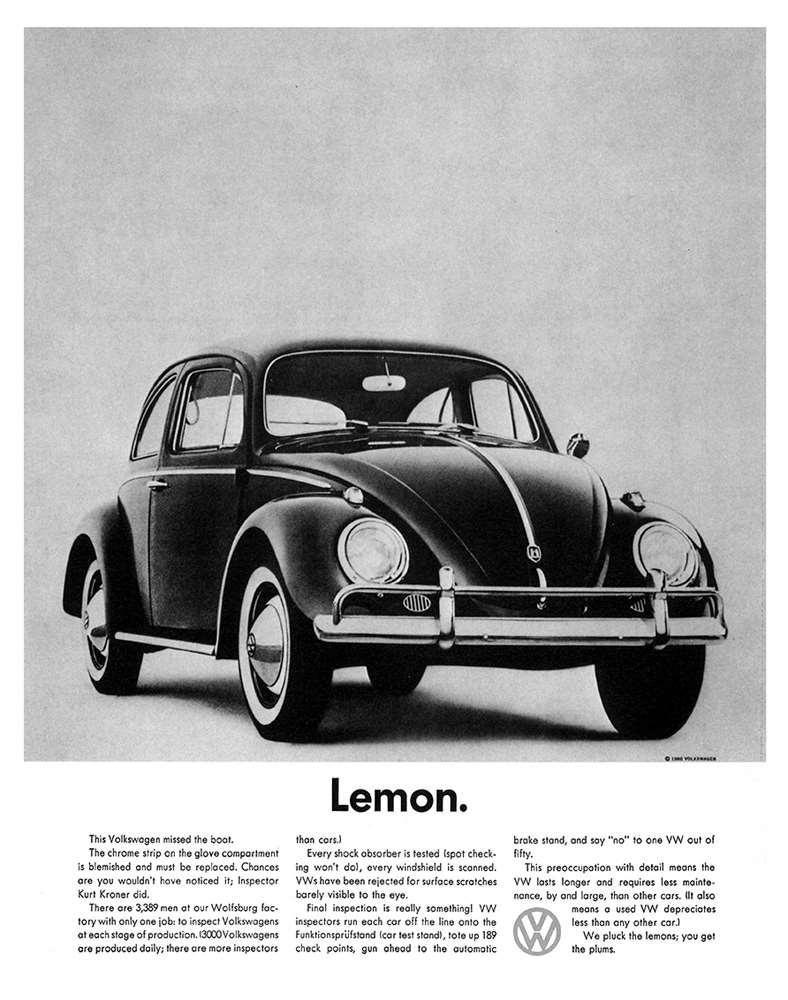 A minimalist Volkswagen Beetle print ad.