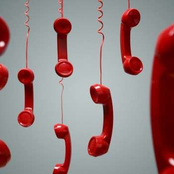 Red telephones are hanging off-hook